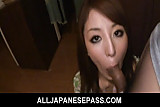 Japanese housewife kneels down for a hot blowjob