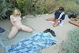 wife masturbating on the beach in front of voyeurs